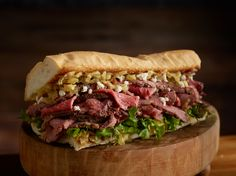 Smoked Tri Tip Sandwich with bacon onion jam, feta cheese, arugula and balsamic on toasted cuban bread