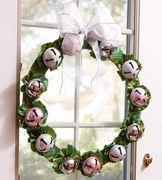 Have a jolly Christmas with a jingle bell wreath. The ensemble of bells will ring every time you open and shut the door, ushering in the sou...