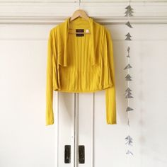 "Anthropologie Suncatcher Cardigan Cropped waterfall cardigan by Guinevere from Anthropologie. ""Perky pointelle sparks the draping flow that surrounds this seasonal cover"" Size M. Mustard yellow. Small cable knit details. cashmere/cotton blend. Anthropologie Sweaters"