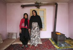 AFGHANISTAN  Noor Zia, 40, poses for a photograph with her daughter Saba Ahmadi, 11, at their home in Kabul February 13, 2014. Noor, who i...