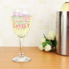 Personalise this She Is... Wine Glass with a name on the front of up to 12 characters and 2 lines on the reverse up to 20 characters each.  'is beautiful amazing kind....' (etc.) and 'Loved lots by' on the reverse is fixed text.  All personalisation will appear in uppercase.  Hand wash only  Due to the nature of this product please note colours may vary and can achieve different results from the images on screen; design has a frosted appearance on the outside of the glass and will appear…