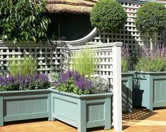 trellis, planter boxes and stained or sealed wooden deck - lots of painting & project ideas here.Decorative trellis, planter boxes and stained or sealed wooden deck - lots of painting & project ideas here. Large Outdoor Planters, Wooden Garden Planters, Fence Planters, Planter Boxes, Planter Ideas, Small Patio, Fall Planters, Design Patio, Small Garden Design