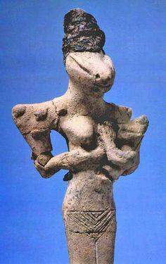 Female Lizard Figure With Baby