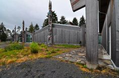 Contemporary Haida Cedar Plank Longhouses and Totem Poles at the Haida Heritage Centre.