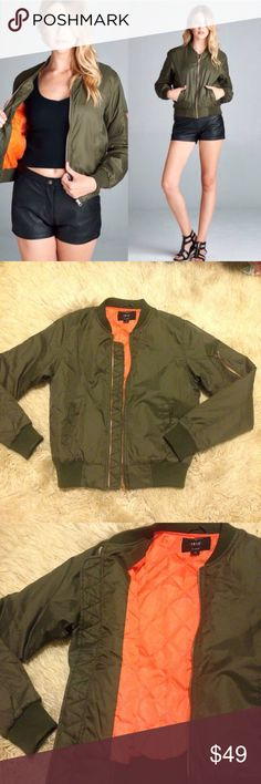 Olive Green Bomber Jacket Just in. As seen on Kylie Jenner. 2-4th photos show the actual jacket. Olive green bomber jacket with an orange inside. Shell-100% nylon.  lining -100% polyester Jackets & Coats Puffers