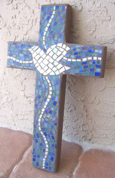 This Stained Glass Mosaic Wall Cross with Peace Dove will make a lovely handmade gift for someone special! This Mosaic Cross is made on a hand cut piece of pine wood. I used stained glass in dark blue, light turquoise blue, and white. The grout is a light mocha brown. I have painted the back …