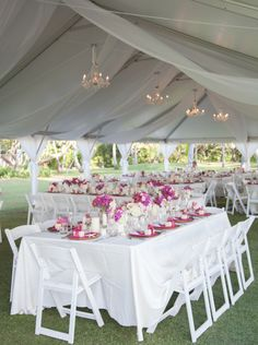 30X60 White Top Tent with white cathedral style swag liner panels and chandeliers