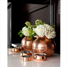 Something as simple as this can instantly make your home trendy this winter - copper accessories are very in. #copper #accessories #decor #winter