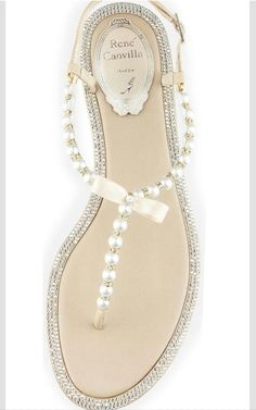 These delicate pearl flip flops are an ideal alternative to traditional bridal shoes at a destination wedding