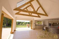 Exposed truss and vaulted ceiling on minimalist kitchen extension - Oakmasters Exposed Trusses, Roof Trusses, Vaulted Ceiling Kitchen, Vaulted Ceilings, Roof Truss Design, Modern Kitchen Island, Building A Pool, Roof Styles, Ceiling Design