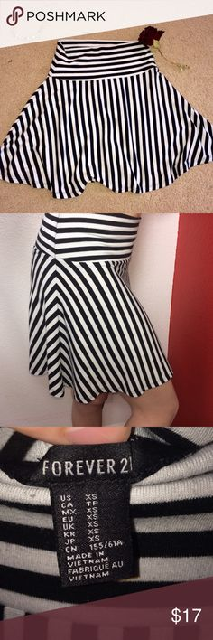 Forever 21  striped skirt Black and white striped skirt from forever 21. Soft fabric with no stains or worn thread. Only worn a couple times. In excellent condition. Can fit a small even though it is extra small! Forever 21 Skirts Mini