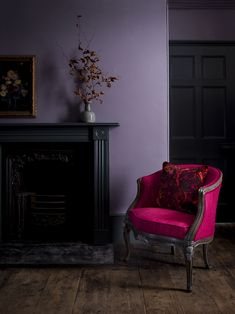 Introducing Matthew Williamson's first ever bespoke furniture collection. Created in collaboration with Nottingham-based sofa manufacturer Duresta, the designs comprise five upholstery ranges and unique occasional pieces. A throw pillow featuring the Marble Butterfly print rests on the red velvet Marianne armchair. The two stand out against a purple wall and a dark wooden floors.