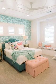 Coral, turquoise and cream white...all the favorite colors for teens, and they go with each other so well and turn out to be so beautiful in this bedroom. The turquoise patterned wallpaper gives more fresh look and the window seat...Love all these without a reason!