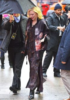 Her rain man: Cate Blanchett was shielded from the rain by an obliging lackey in NYC Thursday