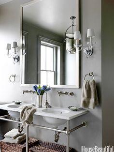 Gray bathroom. Design: Barry Dixon. Photo: Jonny Valiant. housebeautiful.com. #bath #bathroom #gray #sconce