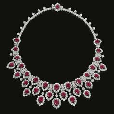 Ruby and diamond necklace by Bulgari, circa 1963. Of fringe design, set with oval and cushion shaped rubies and brilliant cut diamonds, signed Bulgari