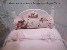 1:12 th scale miniature dollhouse twin Shabby Chic bed in pink with roses and lace via Etsy.