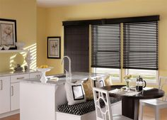 Faux wood blinds reduce solar heat gain and energy consumption, lowering your energy bills.  #BudgetBlinds