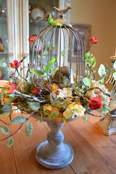 Use a wire birdcage/cloche and a pedestal to make a pretty spring centerpiece!