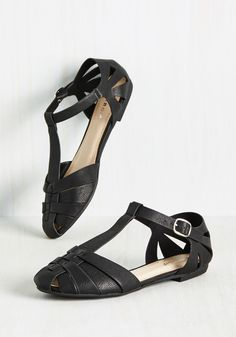Fun-Way Street Sandal. You dont need a flashy adventure to enjoy a sunny day, so after buckling into these black, T-strap sandals, you set off for a one-gal day of play! #black #modcloth
