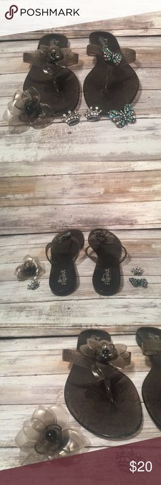 Brown jelly flip out sandals w/ screw on decor Brown jelly flip out sandals with interchangeable design tops that screw on & off. There are 3 sets of jewels to adorn the sandals with. Brown plastic flowers 🌺 , multi colored rhinestone butterflies 🦋 & silver rhinestone crowns 👑 Size 10. Only worn one time. flip Out Shoes Sandals