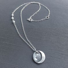 "A charming handcrafted fine silver (.999%) crescent moon pendant with three dainty moonstones wired wrapped to one side. This hangs at 16-17"" on a delicate sterling silver chain. Perfect for everyday wear! ($42) #crescentmoon #moonpendant #handmadejewelry"