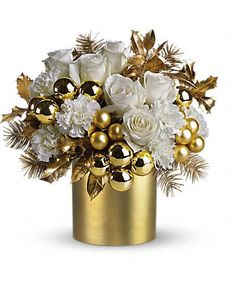 This holiday, go glam! Snow white flowers really shine amongst glistening gold Christmas ornaments, a gold cylinder vase and gold-sprayed Christmas greenery. A fun, unique holiday gift, this arrangement is also a haute pick for holiday party décor. Christmas Flower Arrangements, Christmas Flowers, Christmas Centerpieces, Gold Christmas, Xmas Decorations, Floral Arrangements, Christmas Holidays, Christmas Wreaths, Christmas Ornaments