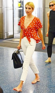 On Emma Roberts:Tularosa top; Mother Insider Crop Step Fray Jeans in Stayin' Alive($195); Aritzia Auxiliary De Bray Backpack($325); Charlotte Olympia Manipedi Sandals($120).