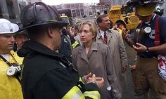 Hillary Clinton listens to firefighters during a tour of the World Trade Center…