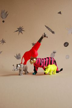 those old plastic animals can become art...