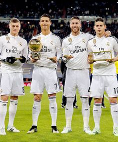 Real Madrid players poses with their trophies that they won at the Ballon d'Or gala before kick off vs. Atletico Madrid | January 15, 2015