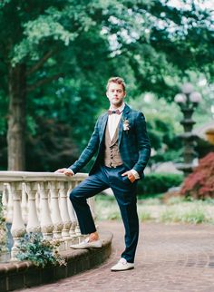 Groom style: Blue plaid jacket and wooden bow tie. Clothes from Revolve in Charlotte, NC, styling by Julian Michael Clark, image by Taken by Sarah Photography at the Mosteller Mansion in Hickory, NC. #wedding