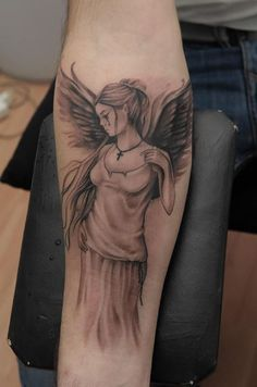 Im not religious, but i like angels. Beautiful tattoo
