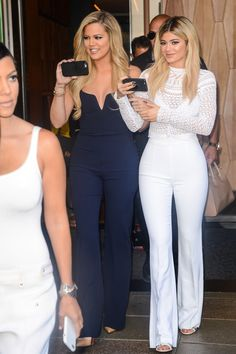 Kylie opted for all-white-everything once again, this time in a sheer blouse and matching high-waisted flared trousers.