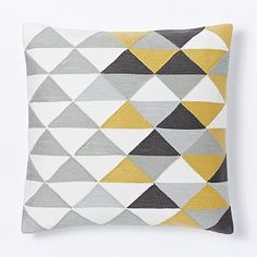 Optical Triangle Crewel Pillow Cover - Horseradish #westelm, $39 (sale $32), for sectional sofa, quantity two (on each corner in front of solid orange pillow)