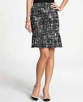 "Sweeping Thatch Print Flounce Skirt - Our graphic print skirt flatters with curve hugging lines and fantastically feminine flounce for a take-notice silhouette. Hidden back zipper with hook-and-eye closure. 21 5/8"" long."