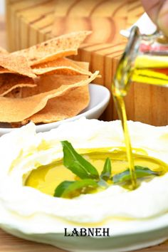 The most common way to eat labneh in the Middle East is scooped up with a piece of Arabic bread or even as a wrap (slather a few tablespoons on Arabic bread / pita bread, add tomato wedges, olives, mint leaves and drizzle some olive oil, wrap it up and serve immediately). If you have never made your own batch, look how easy it is to make at home! There are innumerable ways to serve labneh. Just use your imagination and you will find lots of ways to enjoy this delicately tangy dip! Enjoy! Lebanese Cuisine, Lebanese Recipes, Arabic Bread, Low Carb Recipes, Snack Recipes, Pomegranate Salad, Sandwich Spread, Pita Bread, Plain Yogurt