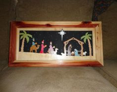 Wooden Christmas Nativity Scene.  Hand scrolled and painted.  Frame is made of Cedar.