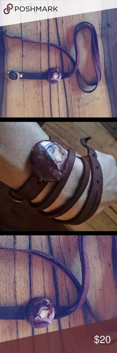 Deep Purple ❤️🙌🏻 leather wrap-around bracelet Bought in Boulder, Colorado from a store that supports at-risk youth by selling their handmade items. Yes! Beautiful leather in a deep reddish purple hue. Flaw in photo: slight discoloration on metal. Wraps around wrist a few times with several holes for fastening at different sizes. (NOT free people, just for exposure). Free People Jewelry Bracelets