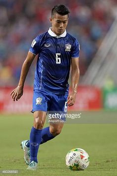 Sarach Yooyen of Thailand controls the ball during the 2014 AFF Suzuki Cup semi final 2nd leg match between Thailand and Philippines at the...