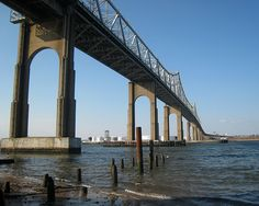 """The Outerbridge Crossing is a cantilever bridge which spans the Arthur Kill. The """"Outerbridge"""", as it is commonly known, connects Perth Amboy, New Jersey, with the New York City borough of Staten Island and carries NY-440 and NJ-440, each road ending at the respective state border."""