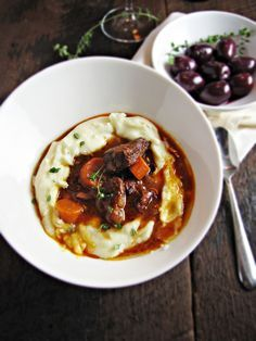 French beef and red wine stew over garlic mashed potatoes