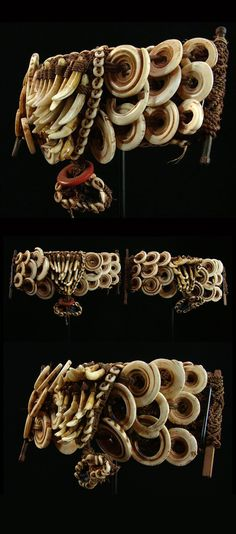 Papua New Guinea | Pair of armbands from Kaiyan Village (near the moth of the Ramu River) | Natural fiber, shells, porcelain dogteeth and German glass trade beads | ca. 1930s | Sold