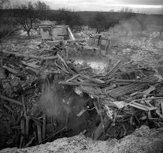 Gomel, Belarus, Ocober 1995..The explosion at the Chernobyl Nuclear Power Plant on April 26 1986 was the worst nuclear accident in history..Bulldozing homes in the closed and radioactive zone surrounding Chernobyl.. Photo:  Jeremy Nicholl