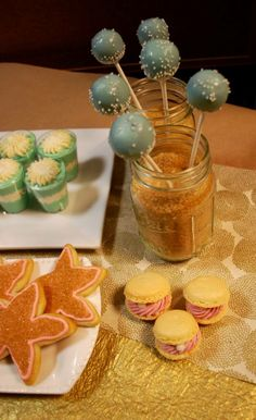 Under the sea party.  Cake pops, oyster macarons, starfish cookies, and parfait cups.