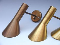 """AJ""   wall lamps  by Arne Jacobsen for  Louis Poulsen 1957  Unusual brass version   4 pieces available  Price: 7500 SEK a piece"