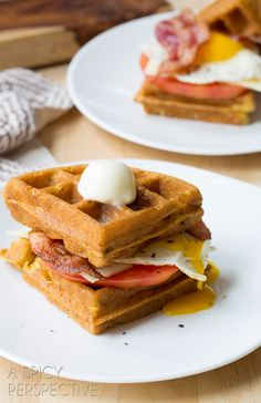 Savory Waffle Sandwich made with Crispy Cornmeal Waffles, Bacon, Eggs, Cheese, and Heirloom Tomatoes!
