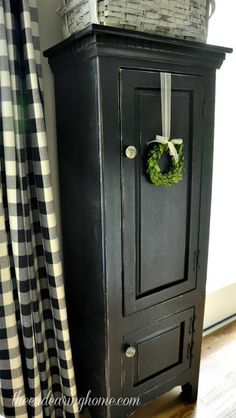 Cottage Charm ~ Love the simplicity of the boxwood wreath hanging on the black armoire - charming! Primitive Homes, Country Primitive, Primitive Decor, Prim Decor, White Cottage, Cottage Style, Country Decor, Farmhouse Decor, Country Charm