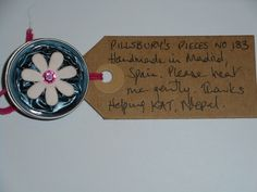 Pillsbury's Pieces No, 183. Pin with metallic teal capsule with pale pink flower. In exchange for a donation to KATHMANDU ANIMAL TREATMENT CENTRE, Nepal. Available at St. George's Church, Madrid on Saturday 13 June from 11.00 - 15.00.