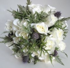 I adore this ivory rose & thistle silk wedding bouquet.  The thistle has always been one of my favourite flowers.  This bouquet is so pretty, natural and lifelike.